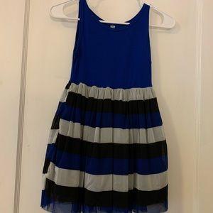 Sleeveless dress with striped petticoat.